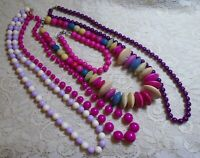 VINTAGE TO NOW ASSORTED PINK & PURPLE WOOD & LUCITE BEADED NECKLACE LOT