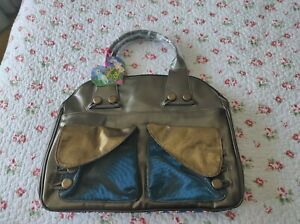 large irregular choice handbag bnwt turquoise , teal and bunny pattern
