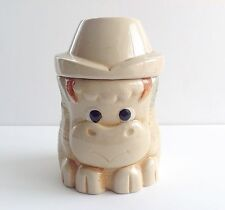 Ceramic cow in a cowboy hat cookie jar