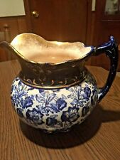 Antique Flow Blue Pitcher with Gold Trim
