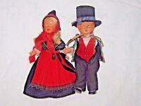 A Vintage Pair of Hard Molded Plastic Head European Folk Dressed Shut Eye Dolls