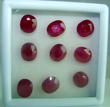 9 facettierte ovale Rubine ( beh. )  mit ca. 45,4 Carat - in Box