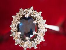 Entourage Ring aus 585/14 Ct Weißgold mit Diamanten 0,12 Ct / Saphir 0,4 Ct