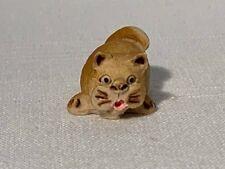 Suprised faced cat figurine