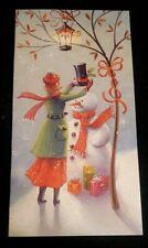 Elegant Carlton Cards Christmas Card, woman giving a Snowman a hat, glitter acc.