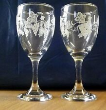 Two genuine vintage sherry glasses with enameled vines.
