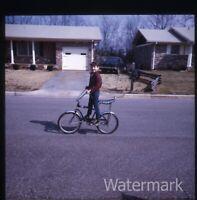 1970s  Photo slide boy on a schwinn stingray bicycle