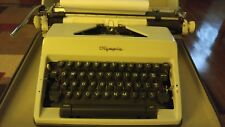 OLYMPIA DeLuxe TYPEWRITER WITH CASE