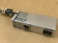 MINOLTA 16 SILVER SUBMINIATURE CAMERA W/ 25MM ROKKOR LENS & STRAP