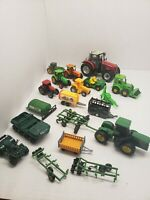 Lot Of Plastic and Diecast Tractors John Deere and others.
