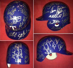 Authentic autograph TEXAS RANGERS 33-alumni signed Rawlings mini helmet w/ stand