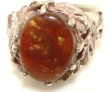Sterling silver cocktail ring set with oval cut brown stone