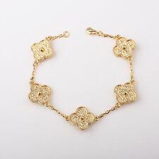 5-motif gold-tone lucky flower bracelet in gold