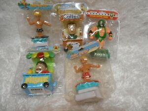New lot 5 solar collectibles bobble heads surfers, coffee & fruit carts, wrestle