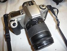 Cámara Canon Eos 300 + Canon 1:3. 5-5.6 II 28-80 mm Lens.. C6