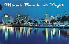 Fla. Miami Beach Night, Illuminated, auto, cars, palm trees, breath-taking sight