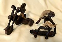 Hand Carved Dark Wood African Statues Pair of Two Skateboard Motorcycle Tiki Bar