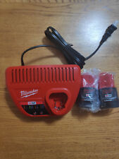BRAND NEW MILWAUKEE M12 CHARGER AND 2 NEW SEALED IN PLASTIC M12 BATTERIES