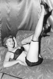 Semi Nude B/W Photo- Sofa- Lifts Leg- Panties- Stockings- Heels- Bra- Smile
