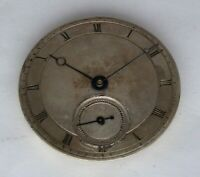 Slim key wind pocket watch movement, silver dial, uncommon type, runs but stops.