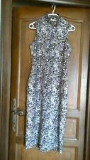 H & M robe neuf, noir et blanc, dos nu 44