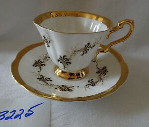 ROSINA  English cup & saucer  Wide Gold Rims Handle & Foot  Black & Gold leaves