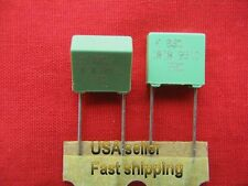 12 pc  -  .01uf 630v (0.01uf, 10nf ) metalized film poly radial capacitors (grn)