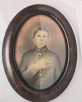 Antique Convex Glass Oval Tiger Frame Photo. Resembles a Civil War Soldier?