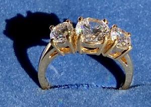 Avon - Gold-tone and Cubic Zirconia - Three Stone Ring - NIB - Size 7 -