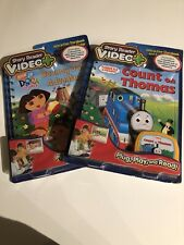 LOT OF  2  VIDEO+ STORY READER  BOOKS & CARTRIDGES THOMAS/ DORA