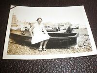 Old Photograph lady sitting on a boat Brighton beach 1931