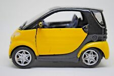 1:33 MAISTO SMART CITY-COUPE Car w/ Opening Doors In YELLOW Color & Black Roof