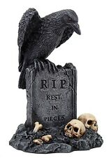 Black Raven Perching On Tombstone RIP Statue.Rest In Pieces.Skeleton and Skull