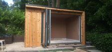 Bispoke Cedar / Larch Garden Room. Aluminium bifolds