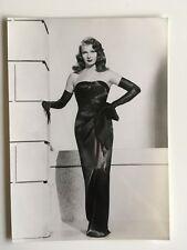 Rita Hayworth Gilda movie publicity photo dressed in sexy evening gown & gloves