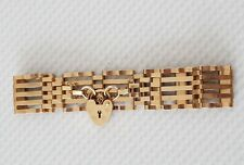 9ct gold 5bar gate bracelet with heart shaped lock and safety chain EX CON 10.8g