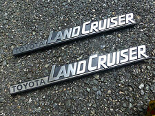 1986 TOYOTA LANDCRUISER (2) SCRIPT EMBLEM BADGE ORNAMENTS