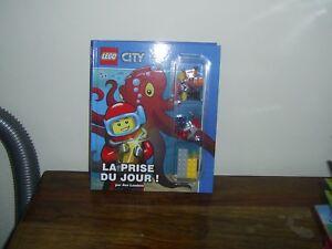 LEGO CITY - LA PRISE DU JOUR - LIVRE + 2 FIGURINES LEGO