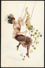 WOMAN on a SWING with Cornucopia New Year Postcard c 1910-12