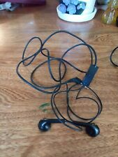 Two sets of Motorola Earbuds and one set of Samsung Cell Phone Earbuds