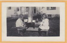 Real Photo Postcard RPPC - Little Boy and Girl and Cat on Bench at Table