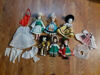 Lot of 6 vintage dolls from around the world other countries with clothes