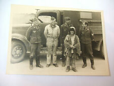 German 2ww photograph of young boy in rags with airmen & lorry