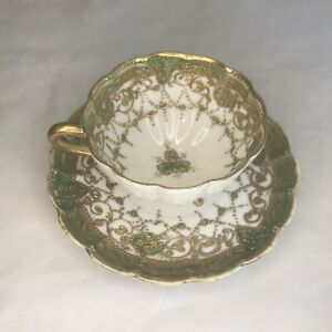Vintage Three Footed Tea Cup And Saucer With Gold Moriage & Clover Design Green