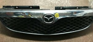 MAZDA 626 1999 MODEL FRONT GRILL / GRILLE AND LOGO CRHOME FITS 08/97-11/99