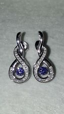 925 STERLING SILVER RHODIUM PLATED TANZANITE AND WHITE SAPPHIRE DANCING STONE...