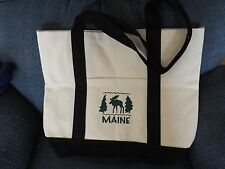 Maine Tote Bag off white w/black straps,moose & pine trees,pocket front,snap