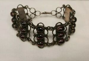 EARLY 20TH C. RARE HANDMADE SILVER WITH BLOOD GARNET BRACELET FOUNDED IN TIBET.
