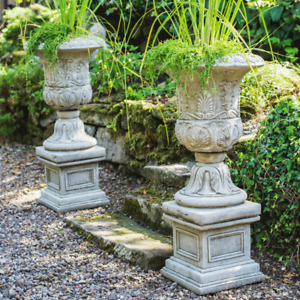 Pair of Large Victorian Stone Cast Urns with Plinths