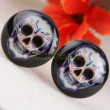 A PAIR OF MENS MANS SKULL THEMED STUD EARRINGS. NEW.